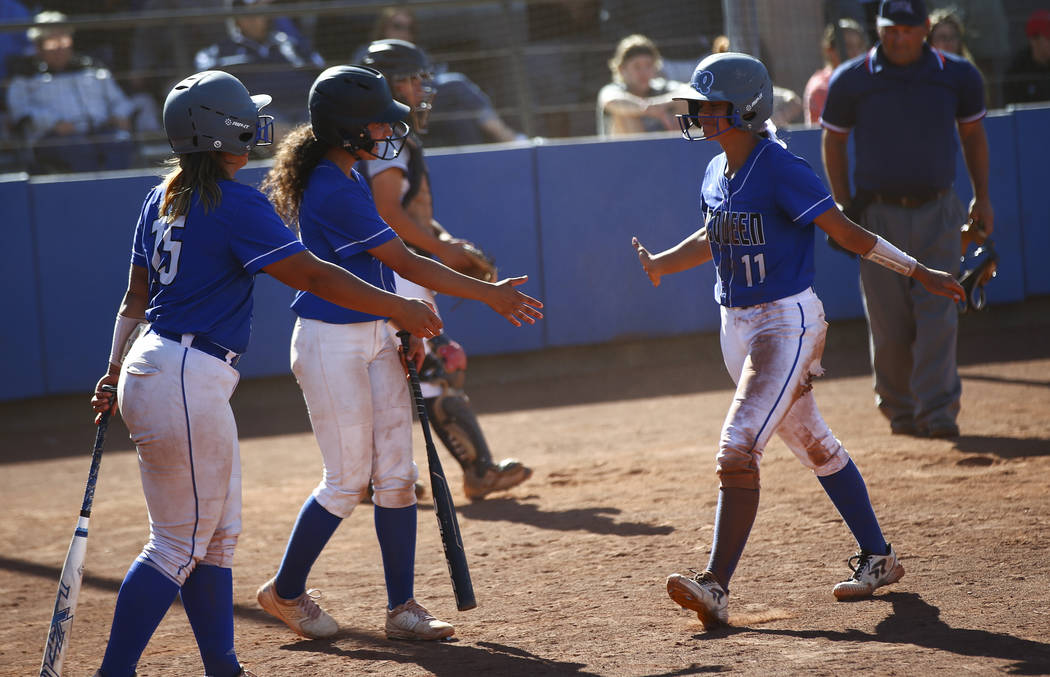 McQueen's Makayla Webber (11) celebrates her run with teammates while playing against ...