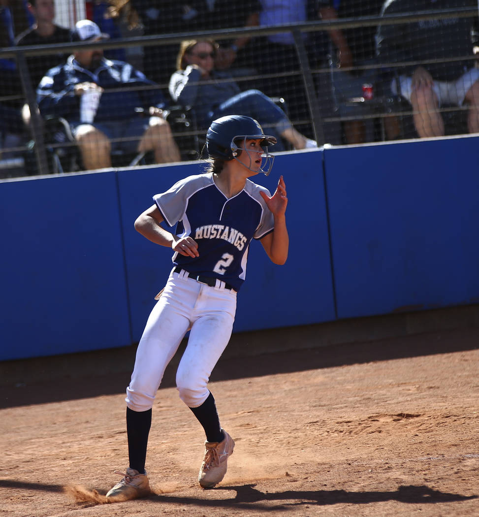 Shadow Ridge's Jasmine Payne (2) scores a run against McQueen during the second round ...