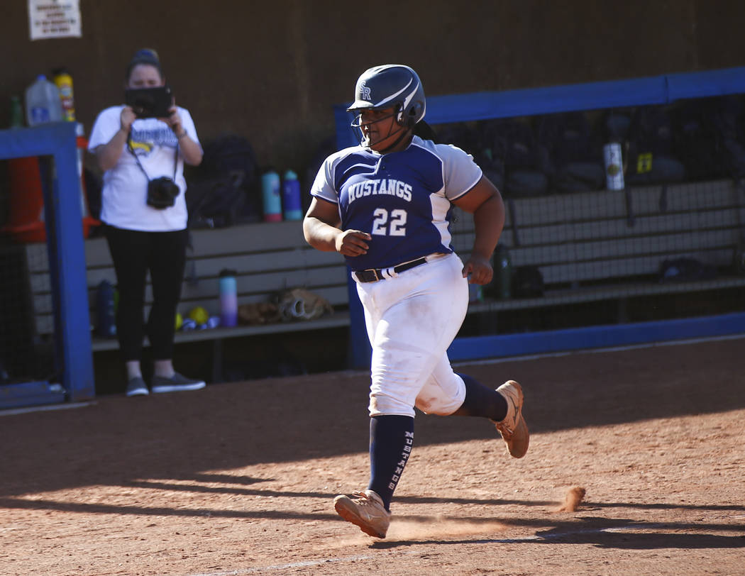 Shadow Ridge's Alyssa Stanley (22) rounds the bases on her home run hit against McQuee ...