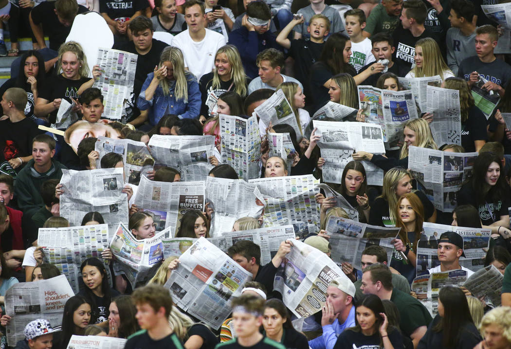 Palo Verde students hold up newspapers as Coronado players are introduced at the start of th ...