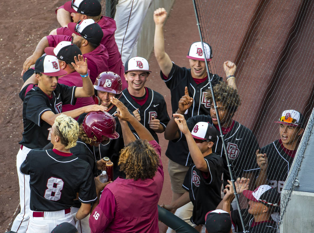 Desert Oasis players celebrate another run over Reno during their Class 4A state baseball to ...