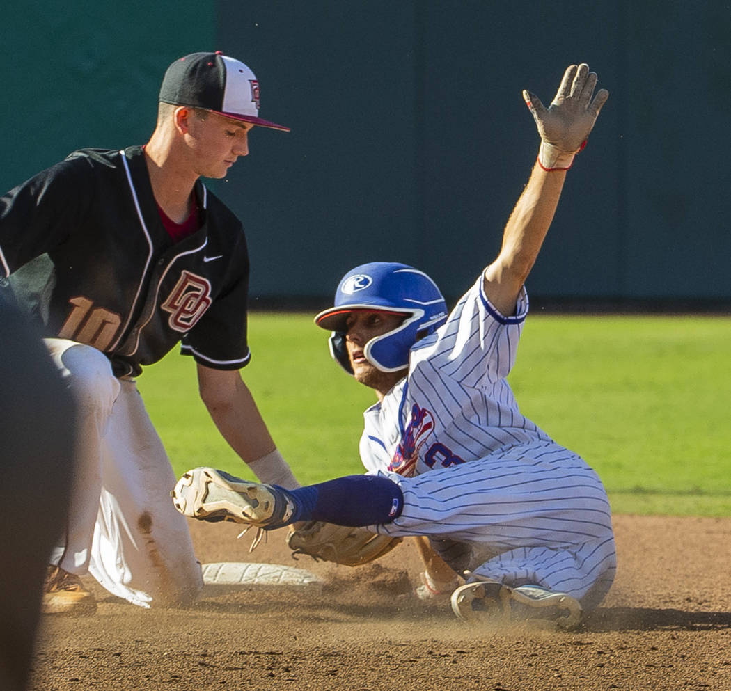 Desert Oasis Colby Smith (10) tags out Reno's Garrett Damico (3) at second base during ...