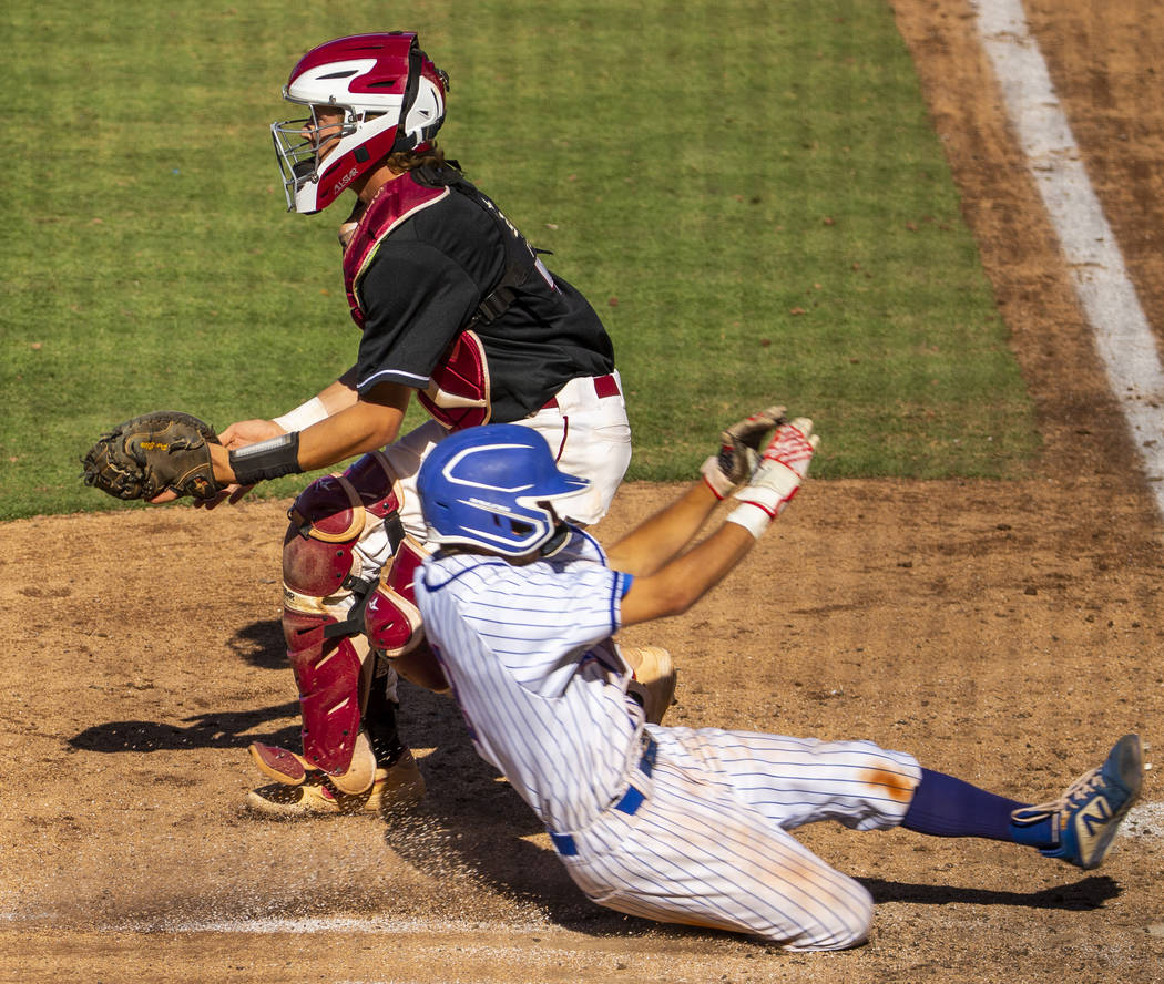 Desert Oasis catcher Parker Schmidt (4) waits for a late throw as Reno's Garrett Damic ...