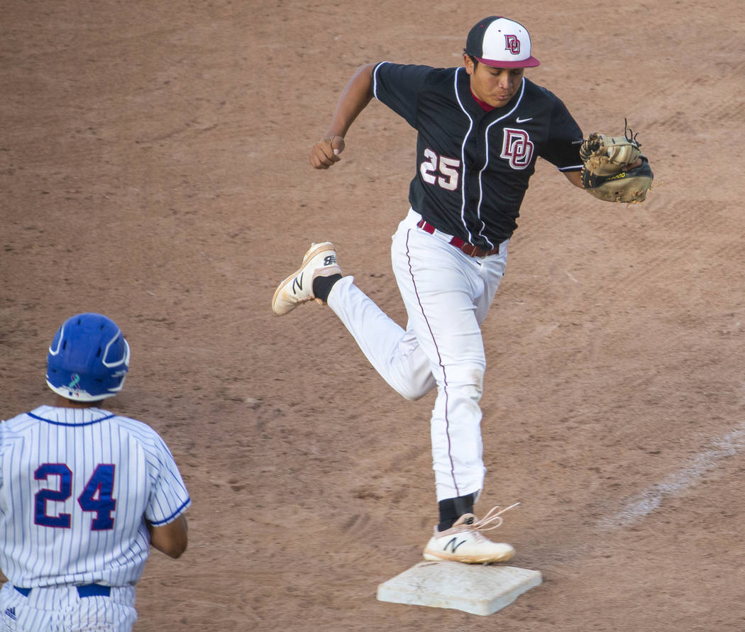 Desert Oasis' Aaron Roberts (25) makes the final out at first base over Reno's S ...