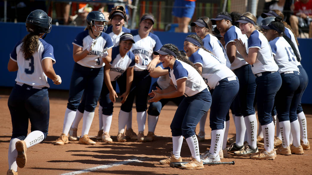 Shadow Ridge players celebrate a home run by Caitlyn Covington (3) in their Class 4A state c ...