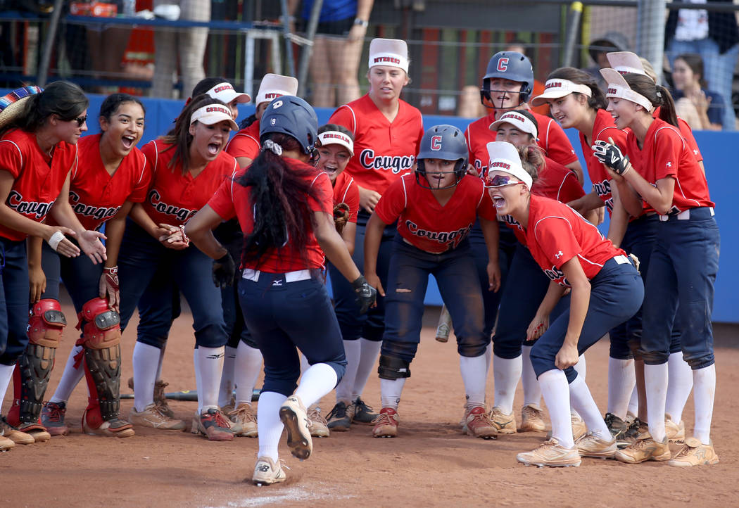 Coronado players celebrate a two-run home run by Kaila Angel (9) against Shadow Ridge in the ...