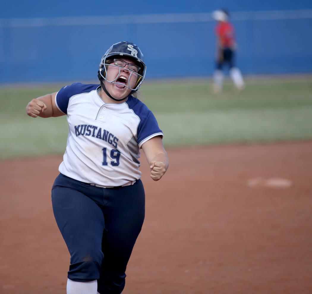 Shadow Ridge Sydney Morgan (19) celebrates her three-run home run against Coronado in their ...