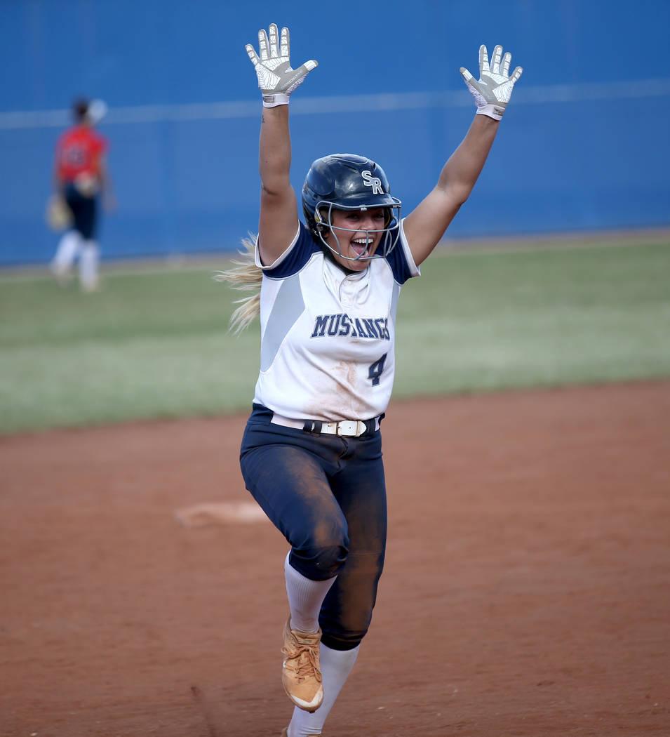 Shadow Ridge's Shea Clements celebrates her go-ahead home run against Coronado in thei ...