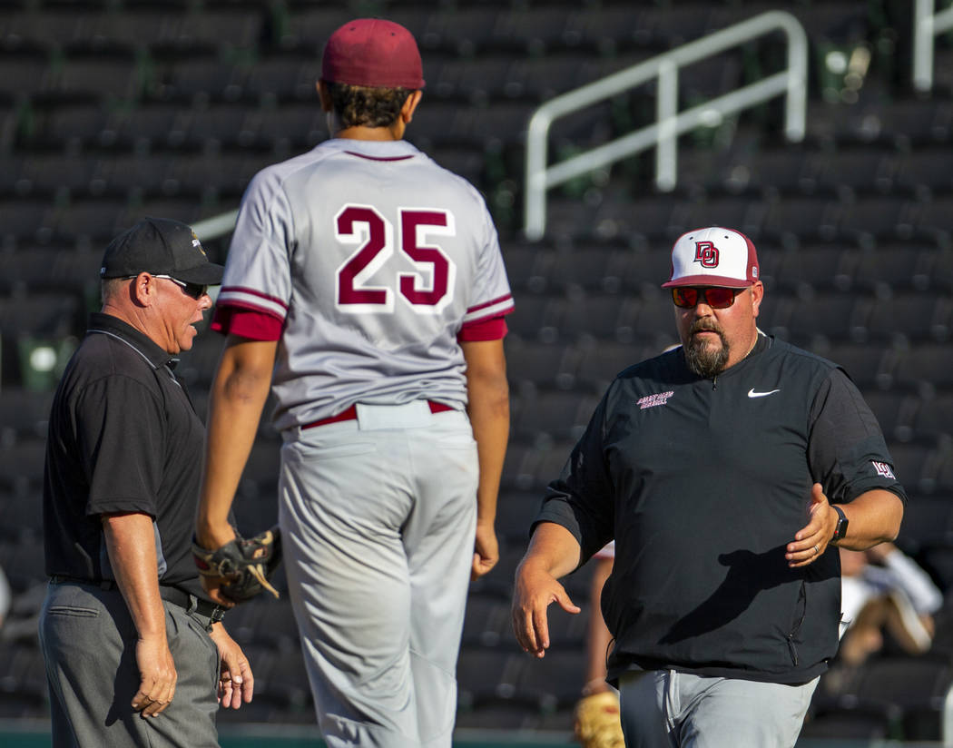 (From right) Desert Oasis head coach Paul Buboltz argues a balk call on his pitcher Aaron Ro ...