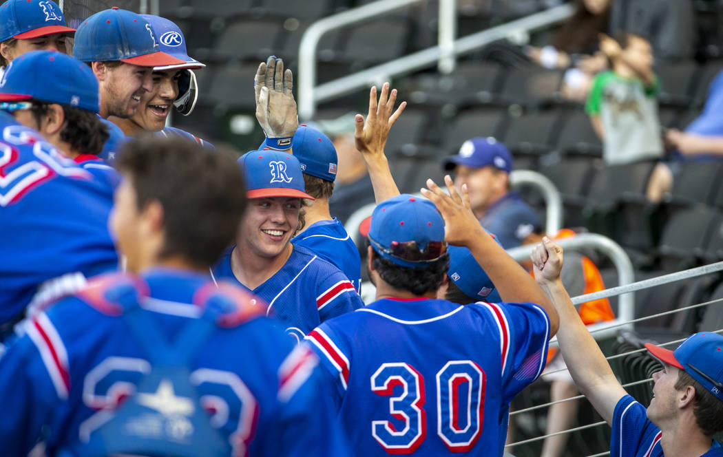 Reno players celebrate their game-winning runs in the sixth inning versus Desert Oasis durin ...