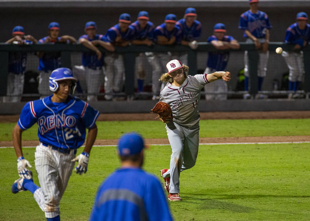 Desert Oasis pitcher Josh Sharman (11, right) throws the final out to first base ahead of Re ...