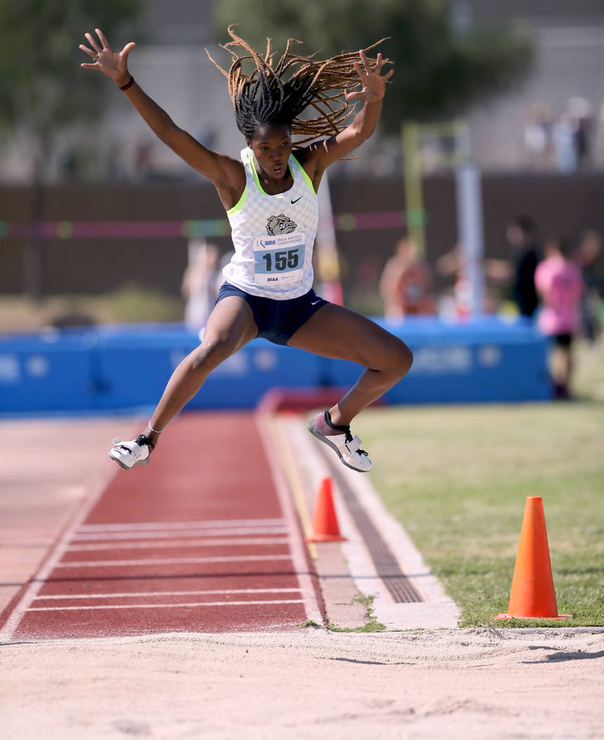 Ashley Moore of Centennial competes in the triple jump during the Class 4A state track meet ...