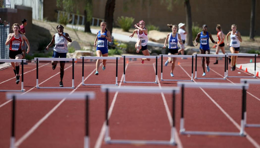 Quincy Bonds Centennial, center, on her way to winning Class 4A 300 meter hurdles in the sta ...