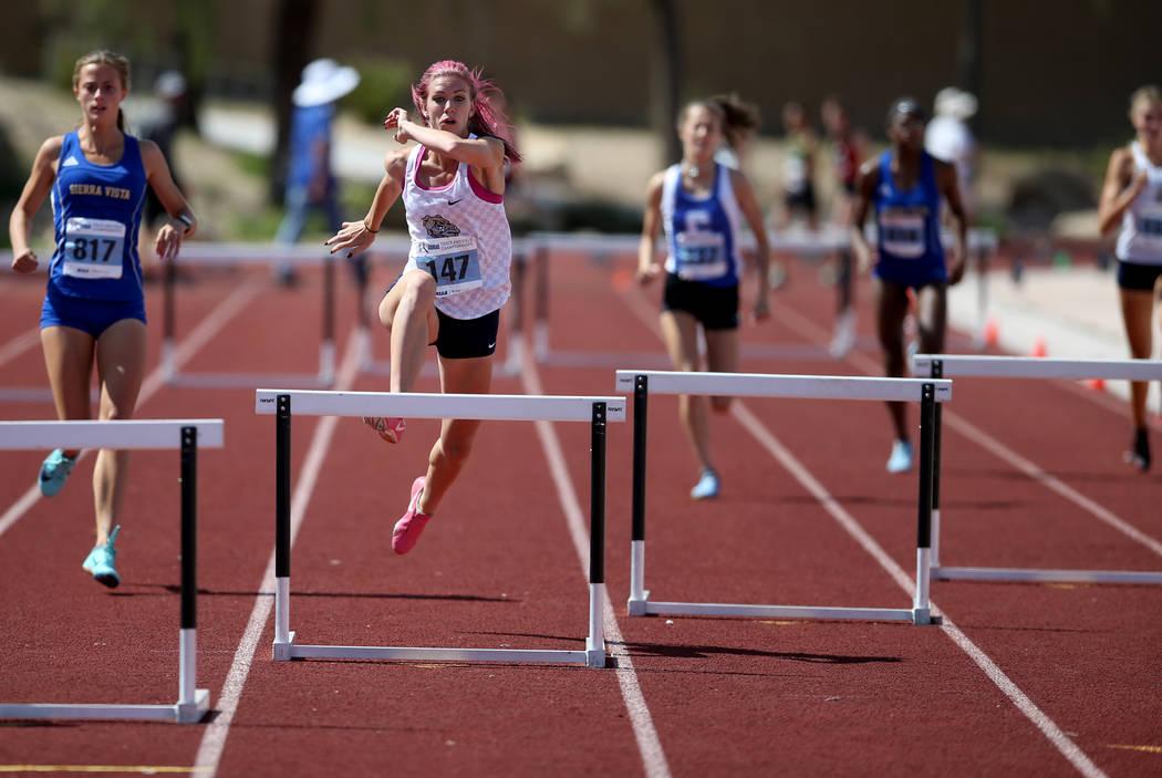 Quincy Bonds of Centennial, second from left, on her way to winning Class 4A 300 meter hurdl ...