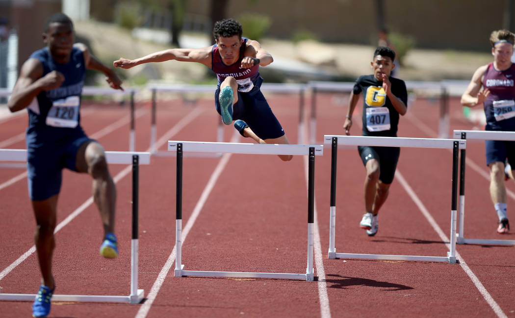 Justin Watterson of Coronado, second from left, on his way to winning Class 4A 300 meter hur ...