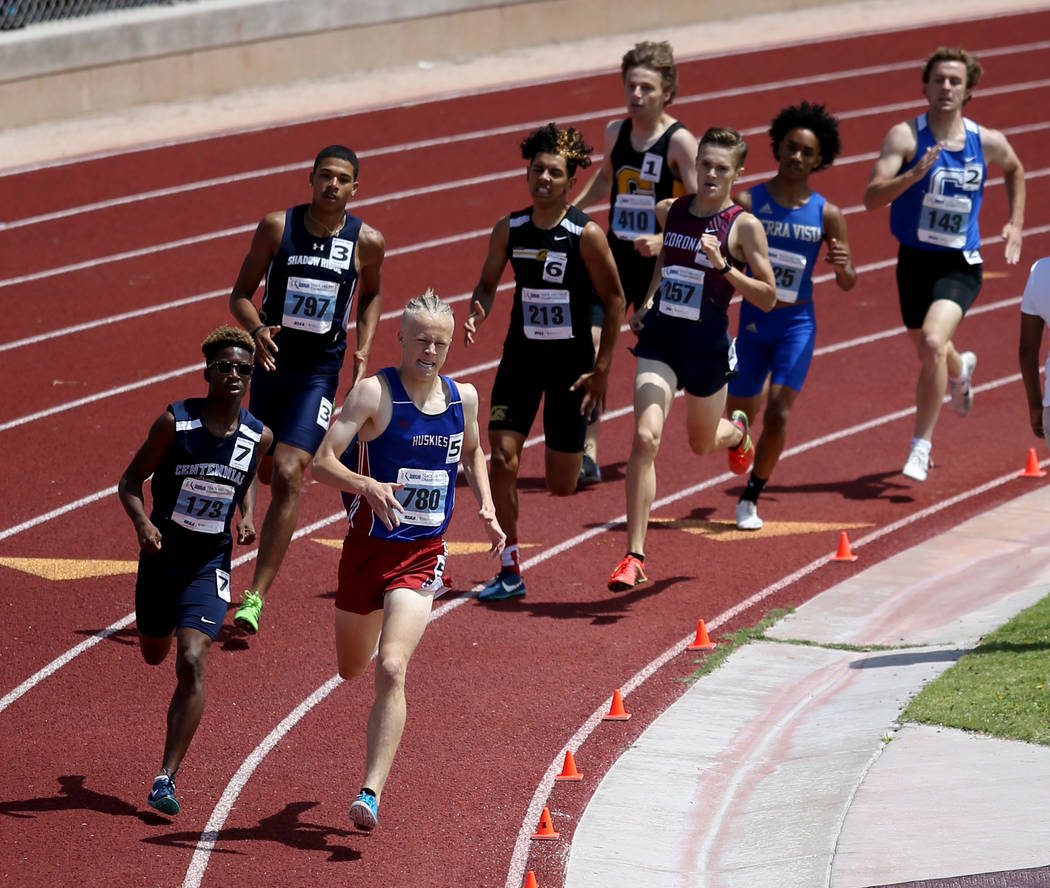 Noah Norris of Centennial, left, and Colby Thomas of Reno battle in the Class 4A 800 meters ...