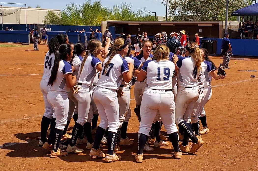 Shadow Ridge players celebrate after Hailey Morrow's single scored Jasmine Martin to g ...