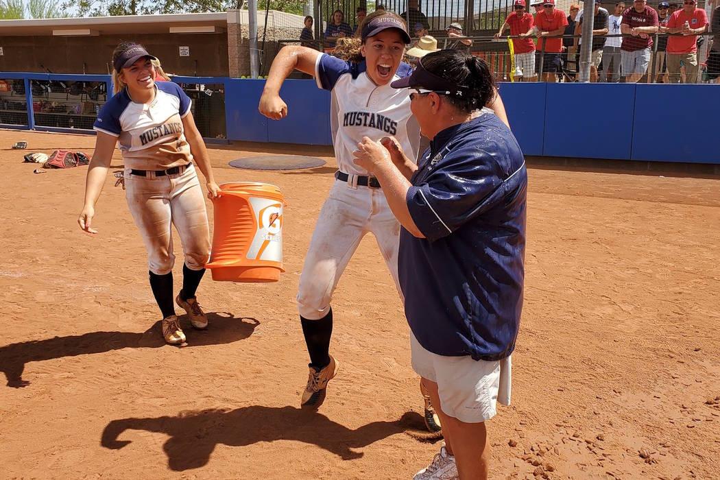Shadow Ridge's Caitlin Covington (center) celebrates after dousing coach Julie Meyn (r ...