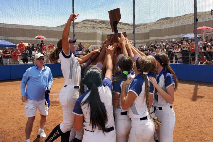 Shadow Ridge softball players hoist the Class 4A state championship trophy after winning the ...