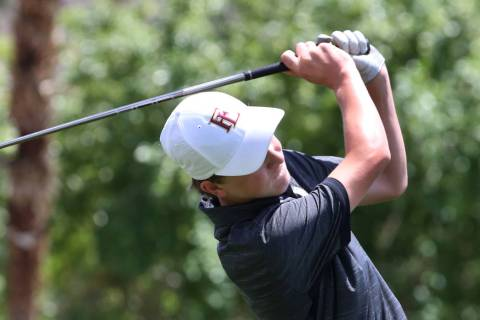 Faith Lutheran's Colton Cherry watches his drive during the Nevada State High School R ...