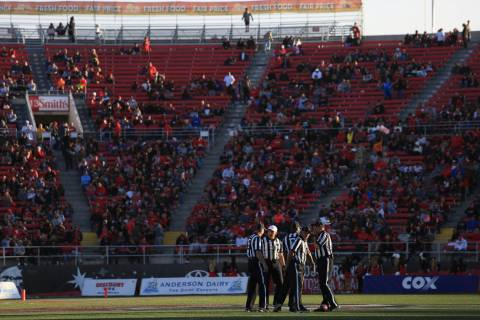 Referees meet at midfield during a tv timeout during the UNLV Nevada football game at Sam Boyd ...