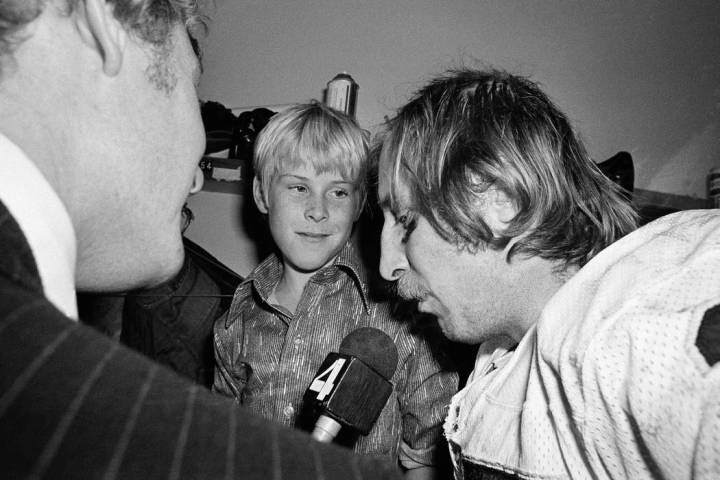 Ten-year-old Fred Biletnikoff Jr., center, looks in admiration at his father, one of the sta ...
