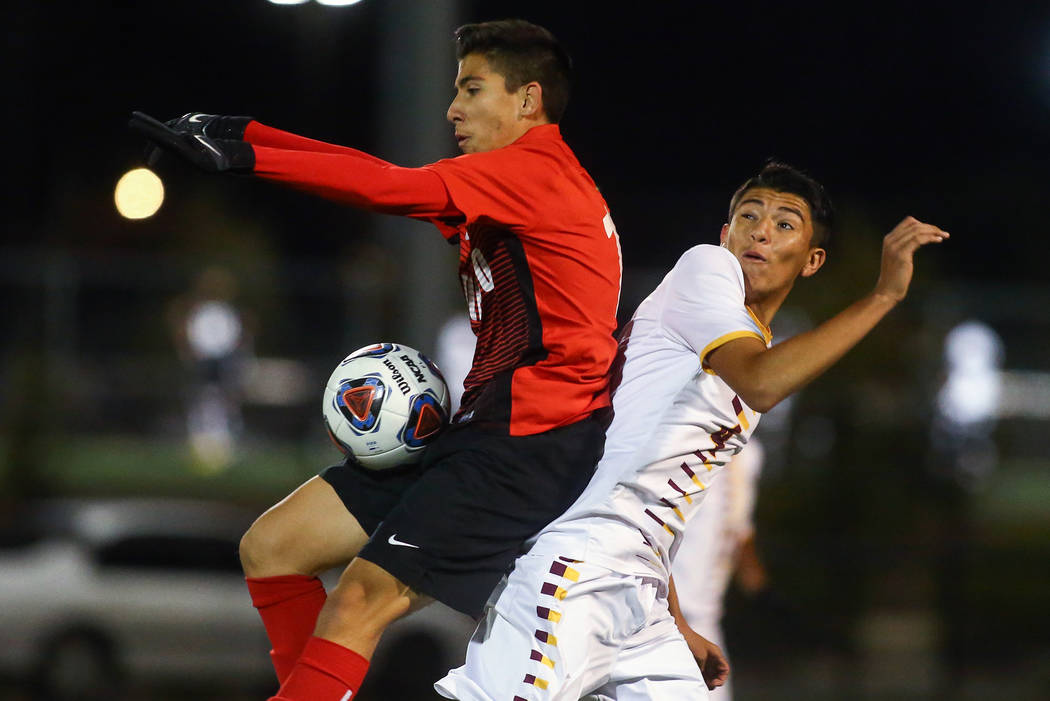 Coronado's Diaz Alfredo (13) traps the ball while under pressure from Eldorado's ...
