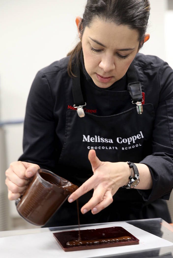 Melissa Coppel makes chocolate at her Las Vegas chocolate school Thursday, May 16, 2019. At lef ...