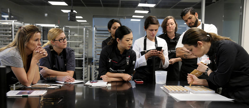 Melissa Coppel, right, teaches chocolate making at her Las Vegas chocolate school Thursday, May ...