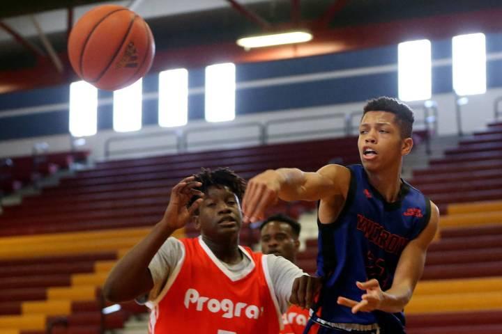 Las Vegas Knicks guard Nick Blake (23) makes a pass during his basketball game at Del Sol Ac ...