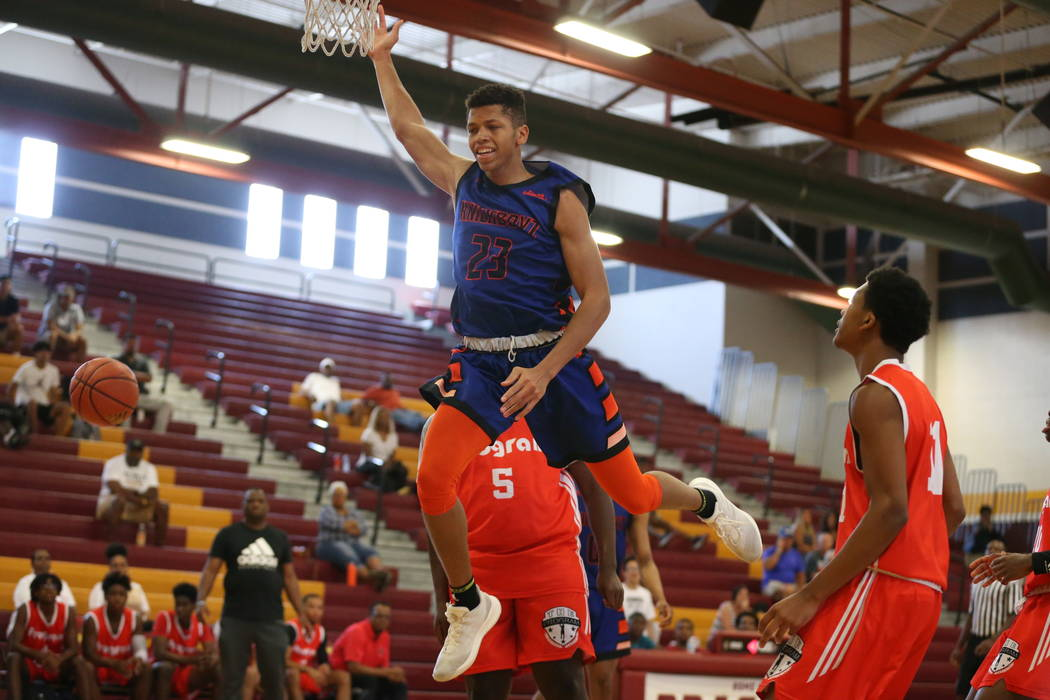 Las Vegas Knicks guard Nick Blake is fouled (23) during his basketball game at Del Sol Acade ...
