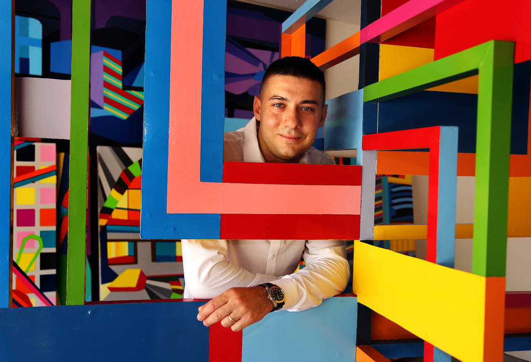 Conceptual artist Valentin Yordanov with his sculptures Urban Symphony and Urban Dynamics, at h ...