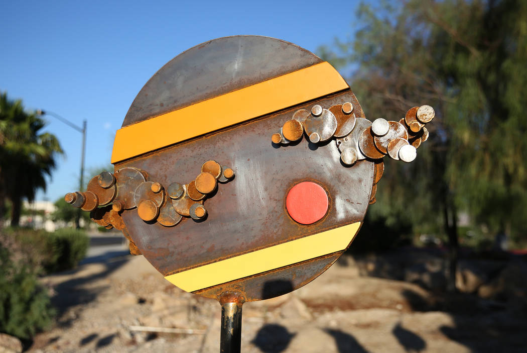 """Artist Randy Mendre's sculpture """"Solar Walk"""" is displayed at at the corner of North B ..."""