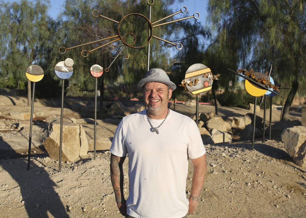 Artist Randy Mendre poses for a photo on Wednesday, June 19, 2019 in front of the sculpture he ...