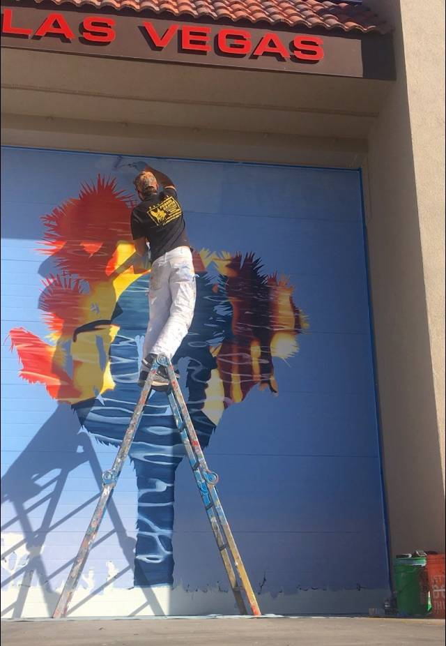 "Erik Burke painting ""Right Place, Wrong Time: at Fire Station 103. Erik Burke"