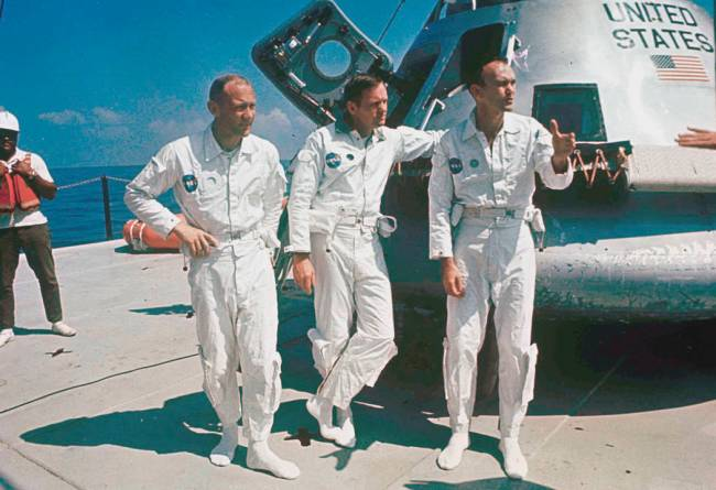 FILE - In this 1969 file photo, Apollo 11 astronauts stand next to their spacecraft in 1969, f ...