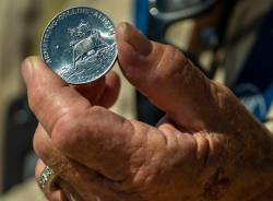 Ernie Williams with commemorative coin from the Apollo 11 mission within the Nevada National Se ...