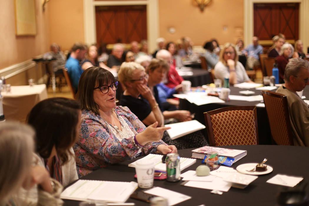 Stephanie Ruckstuhl, of Canada, asks a question at the International Lewy Body Dementia Confere ...