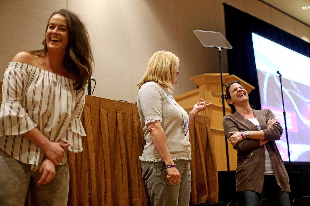 Katie Boer, from left, Carolyn Leavitt, and Melanie Lewis laugh while participating in an exerc ...