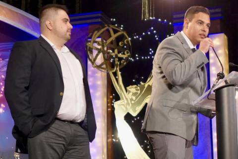 Raul Saldivar, left, and Leo Saucedo accept an award at the 2019 National Academy of Television ...