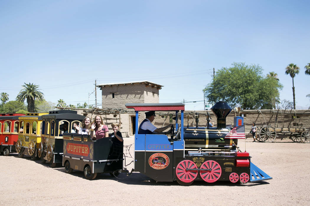 Attendees enjoy a train ride during Pioneer Day at Old Mormon Fort in Las Vegas, Saturday, July ...