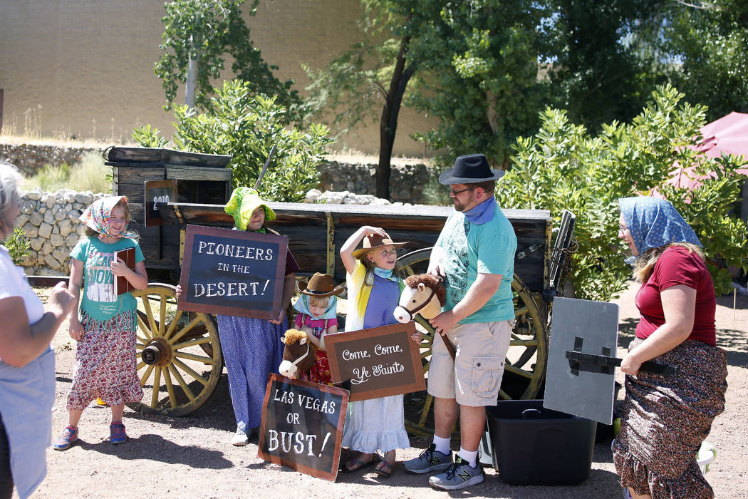 A family gets ready for the photo booth during Pioneer Day at Old Mormon Fort in Las Vegas, Sat ...