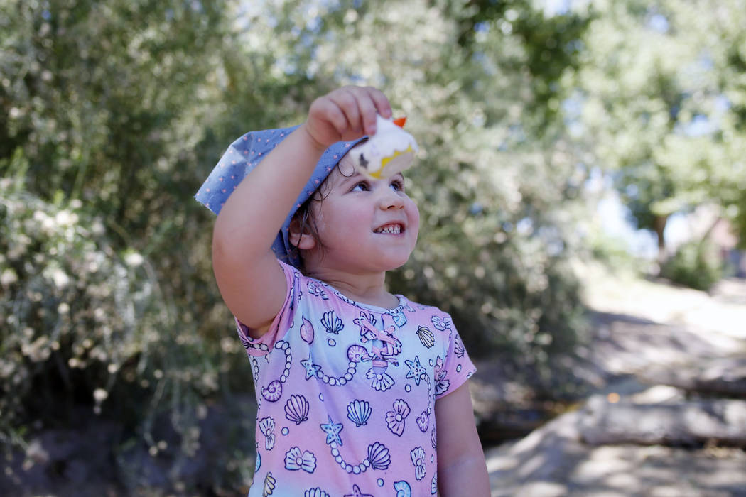 Addy Bartlett, 4, visiting family in Las Vegas, holds her plastic duck used in the duck race du ...