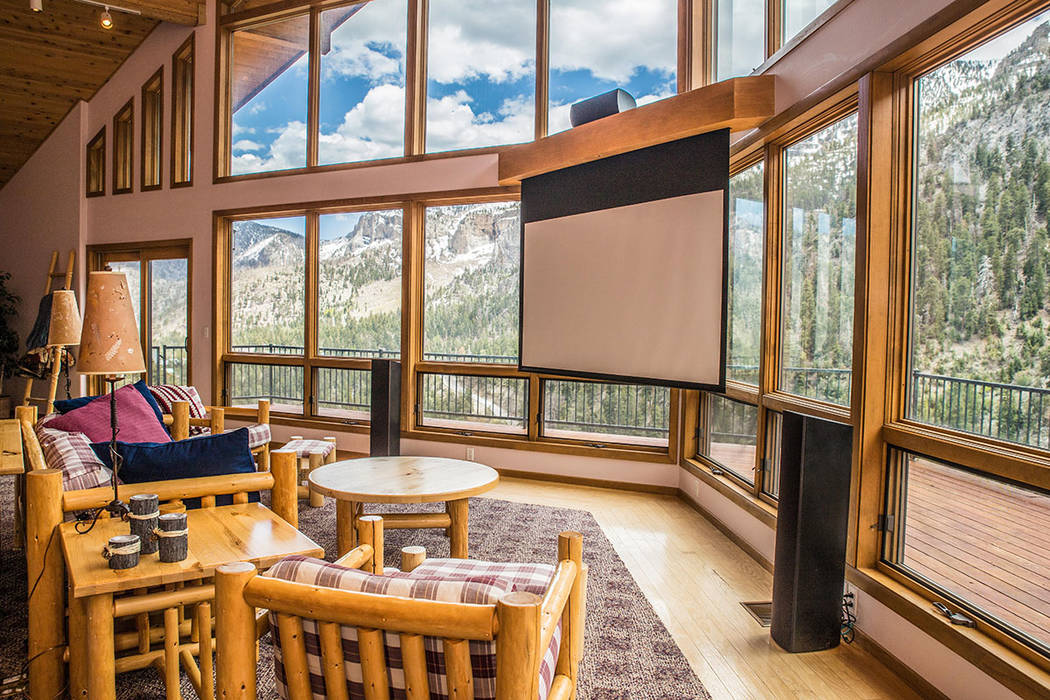 The living room has a large window wall for view the forest. (Tonya Harvey Real Estate Millions)