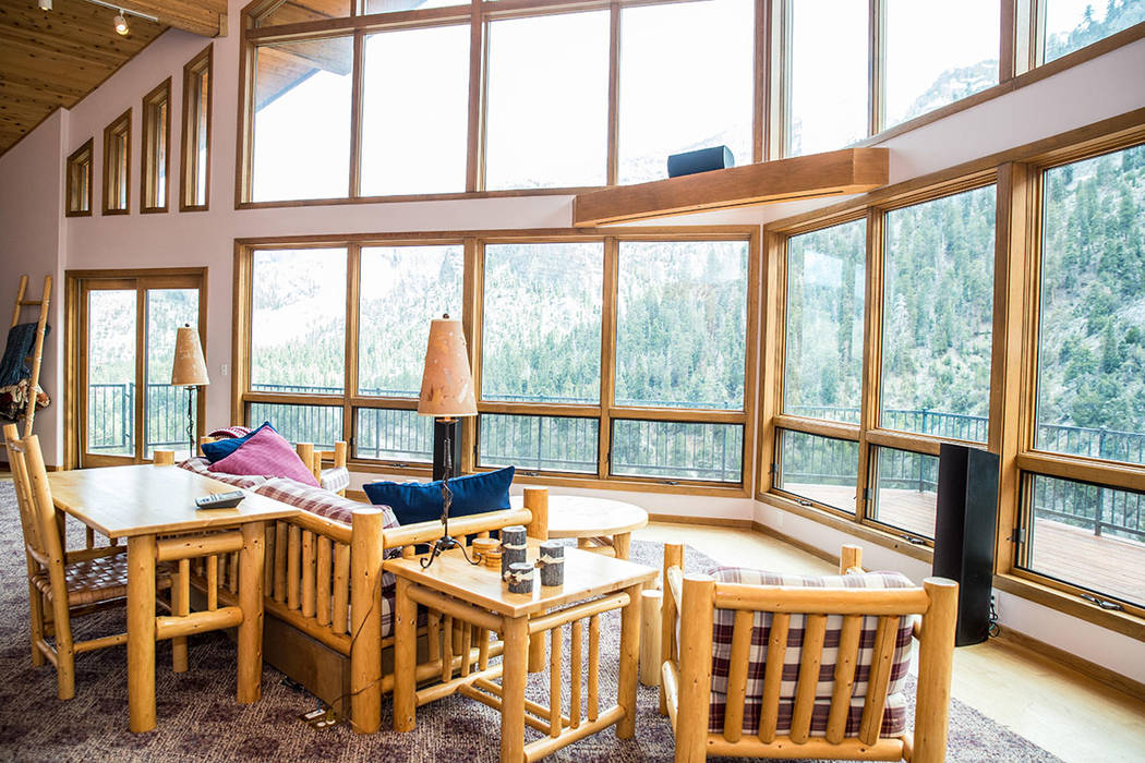The living room has sweeping views of the mountains and forest. (Tonya Harvey Real Estate Millions)