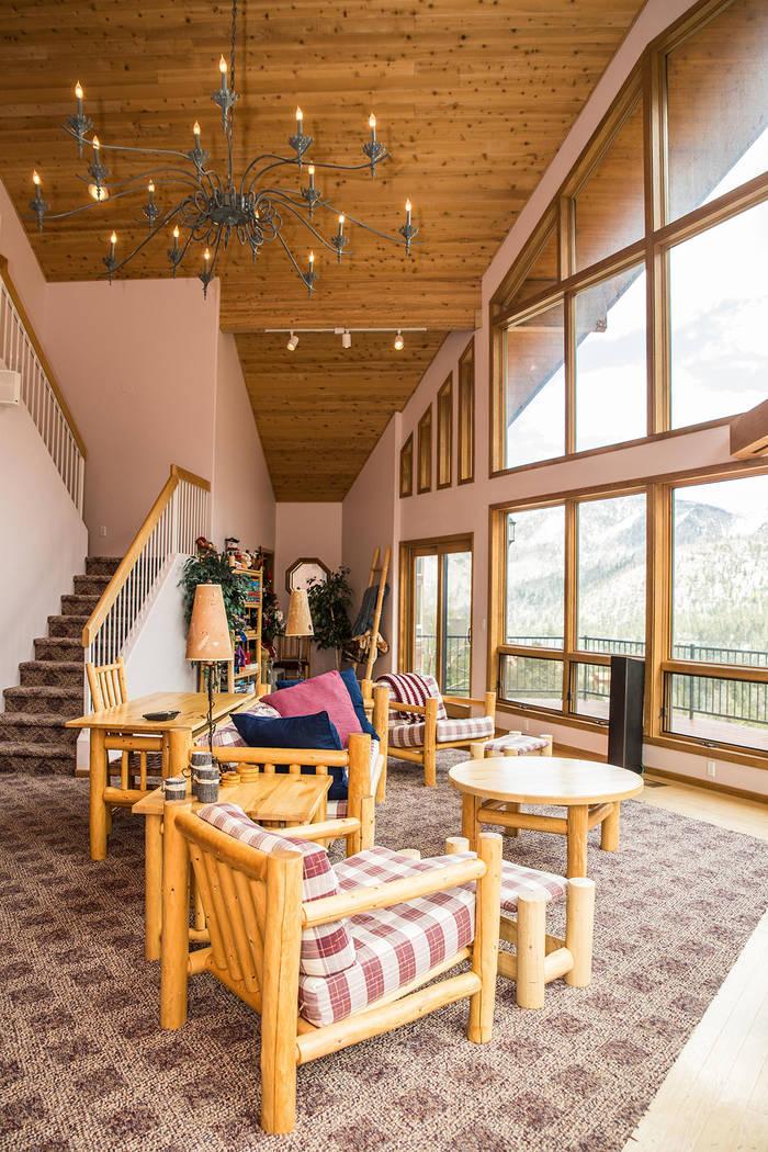 The living room has high ceilings. (Tonya Harvey Real Estate Millions)