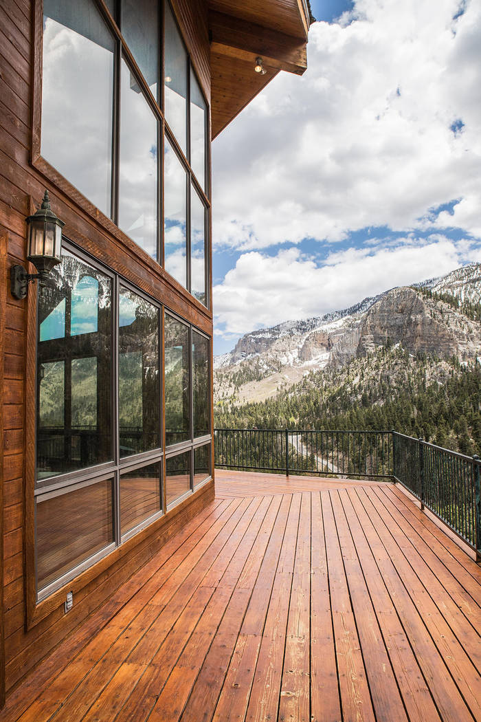 The mountain home has plenty of window walls to view the pine forest and mountains. (Tonya Harv ...