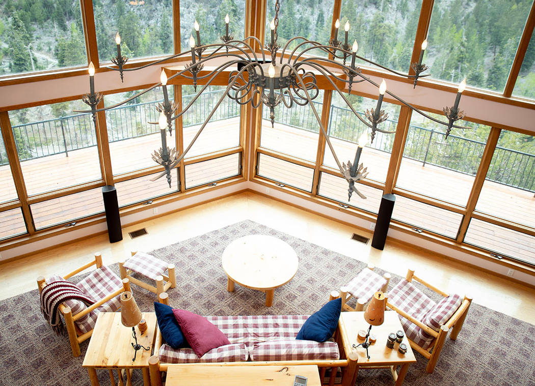 The living room is large and leads to a warparound balcony. (Tonya Harvey Real Estate Millions)