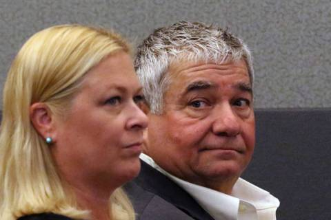 Former Henderson Constable Earl Mitchell, right, appears in court at the Regional Justice Cente ...