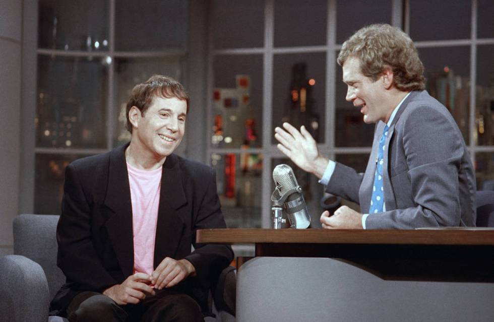 """Performer Paul Simon listens to David Letterman on the set of NBC's """"Late Night with David Lett ..."""